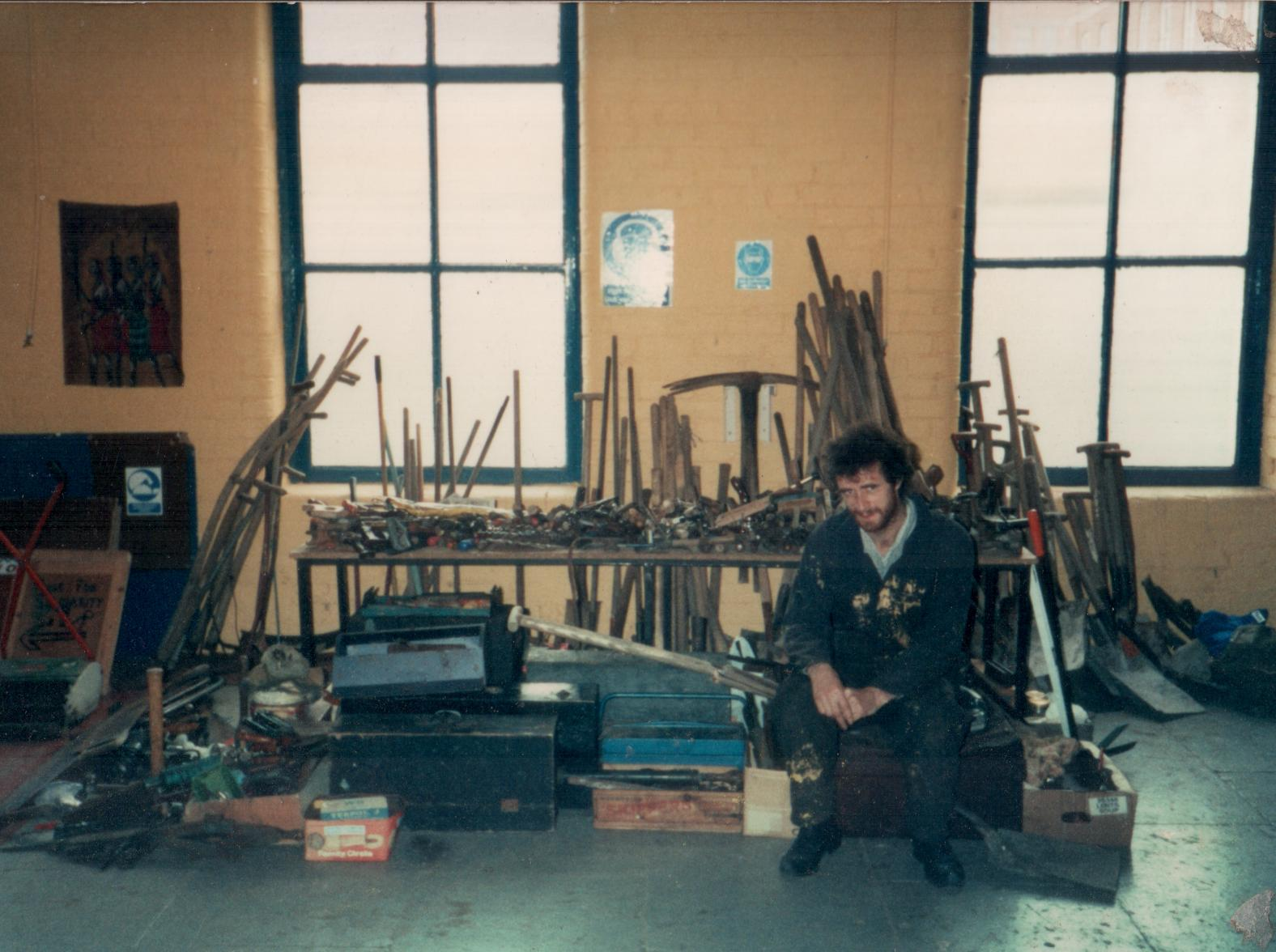 John with tools in the workshop in Crumlin Rd